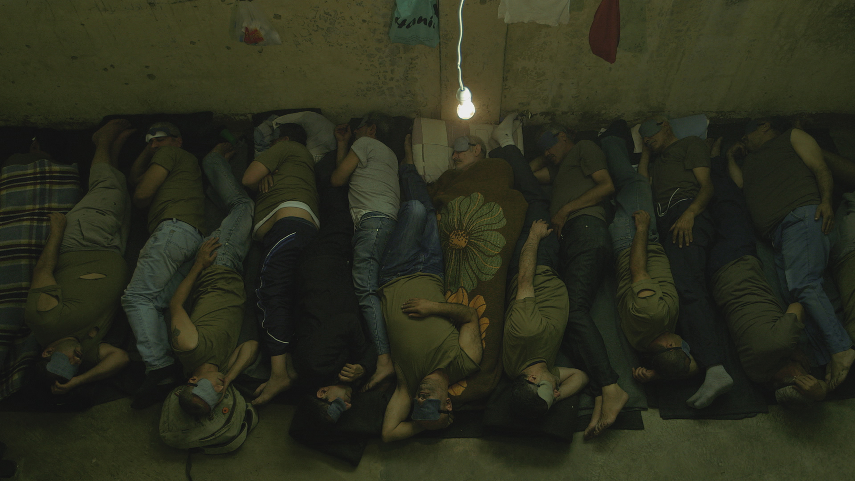Prisoners sleeping in a collective cell