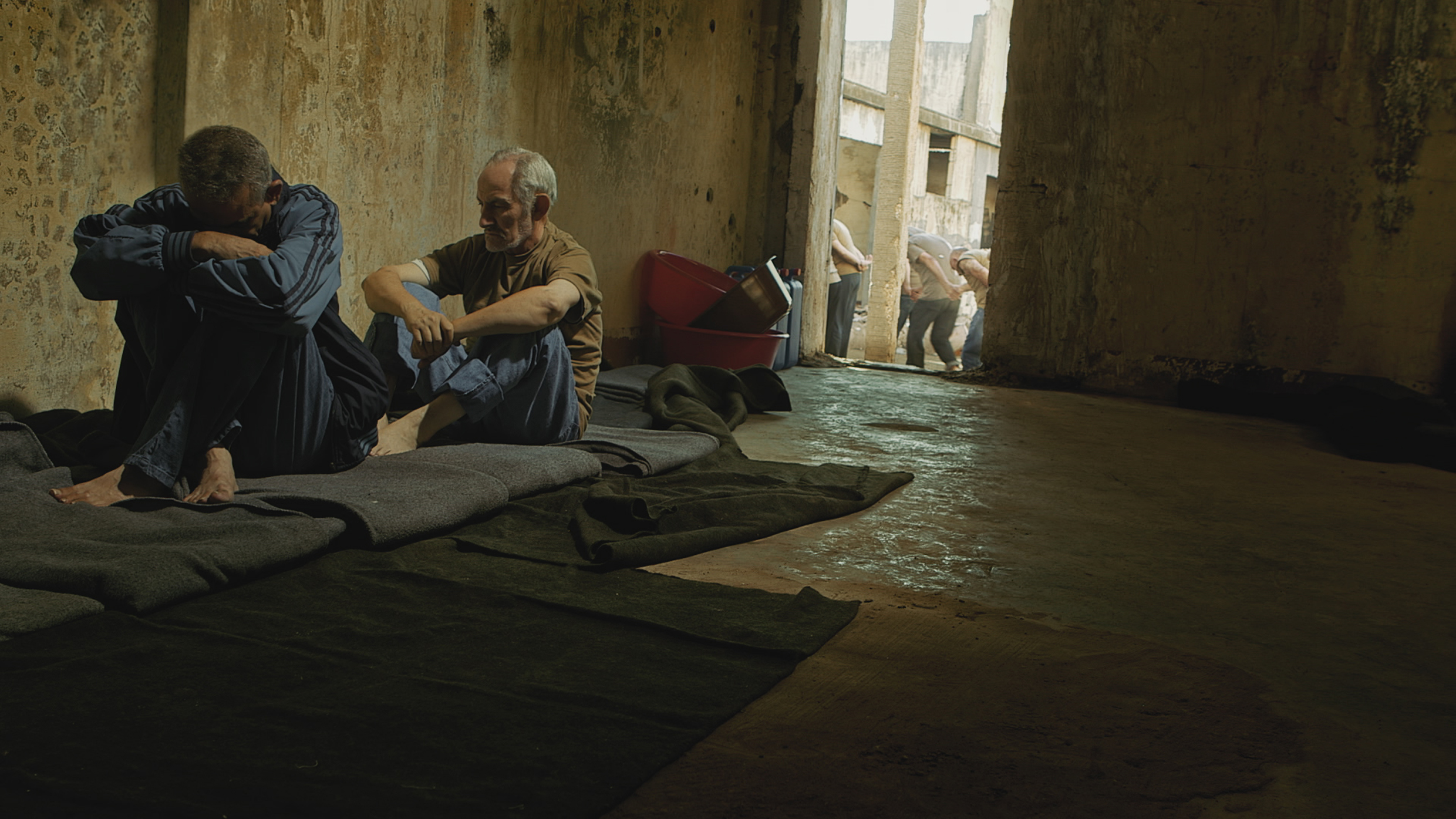 2 men sitting in a collectiv cell